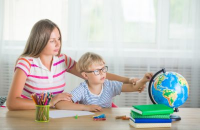 cute-child-learning-lesson-with-his-mother-family-doing-homework-together-mothe-explaining-her-little-schoolboy-how-task_136813-1733