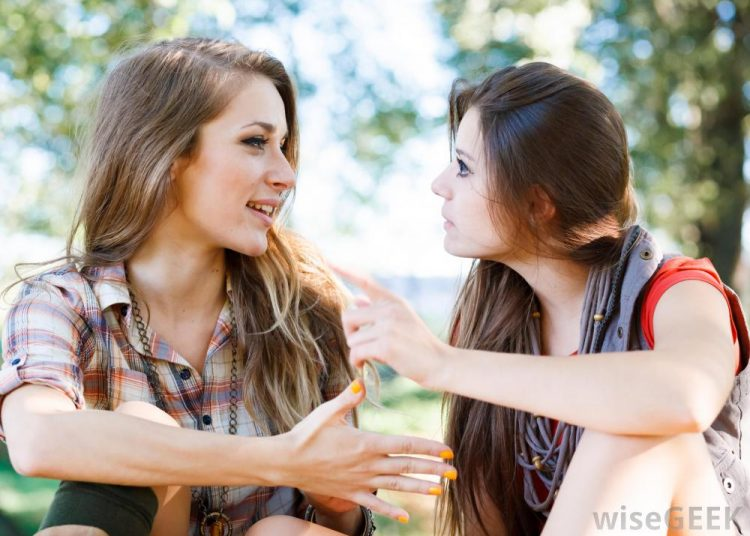 two-young-females-talking-to-each-other